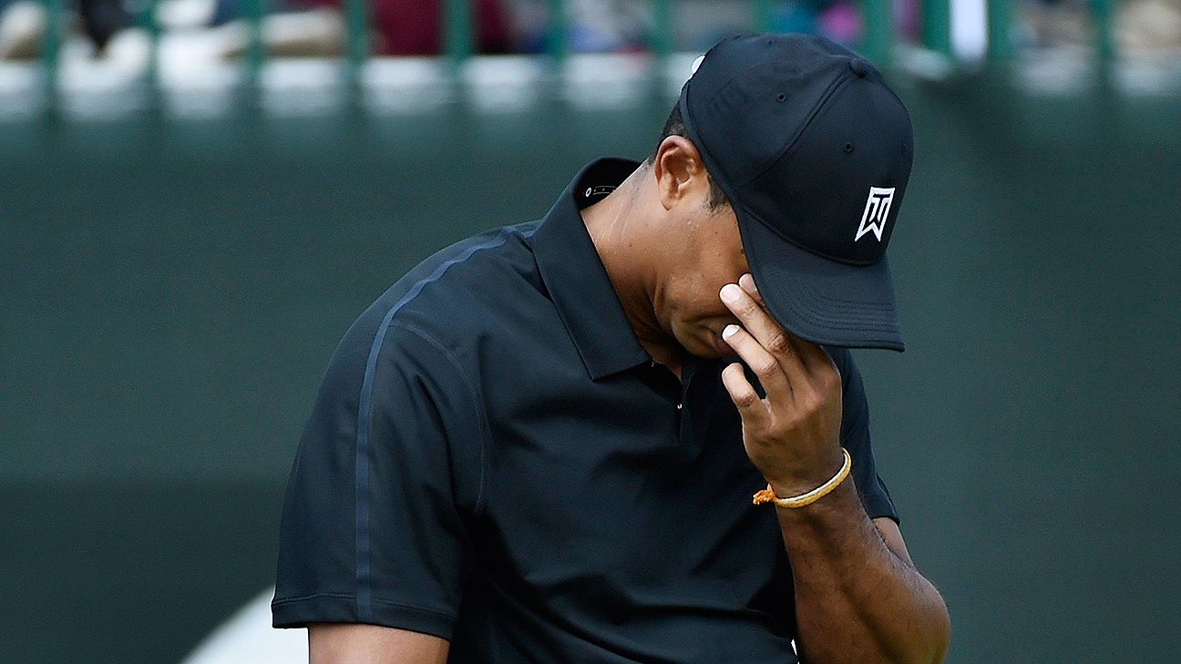 Tiger Woods makes cut on number