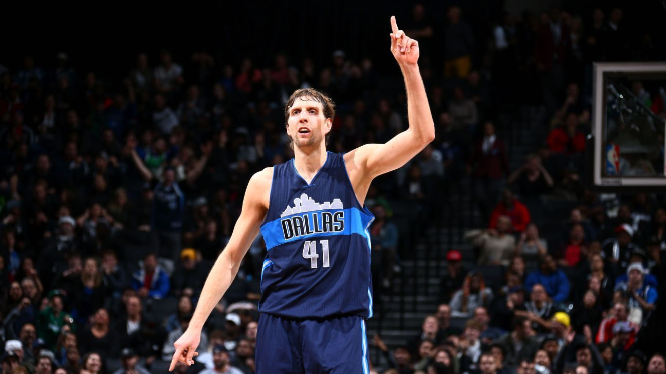 Dirk Nowitzki of Dallas Mavericks passes Shaquille O Neal for No