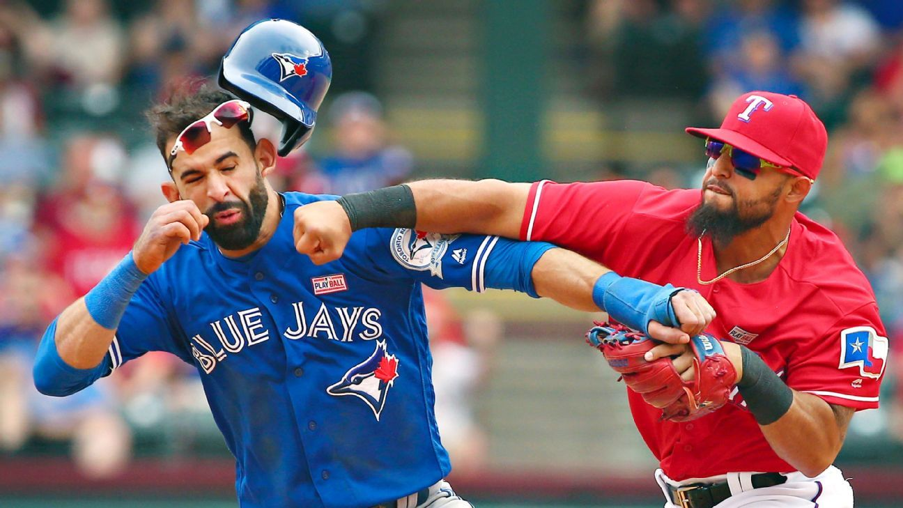 Texas Rangers' Rougned Odor lands punch to face of Toronto Blue Jays' Jose Bautista during brawl