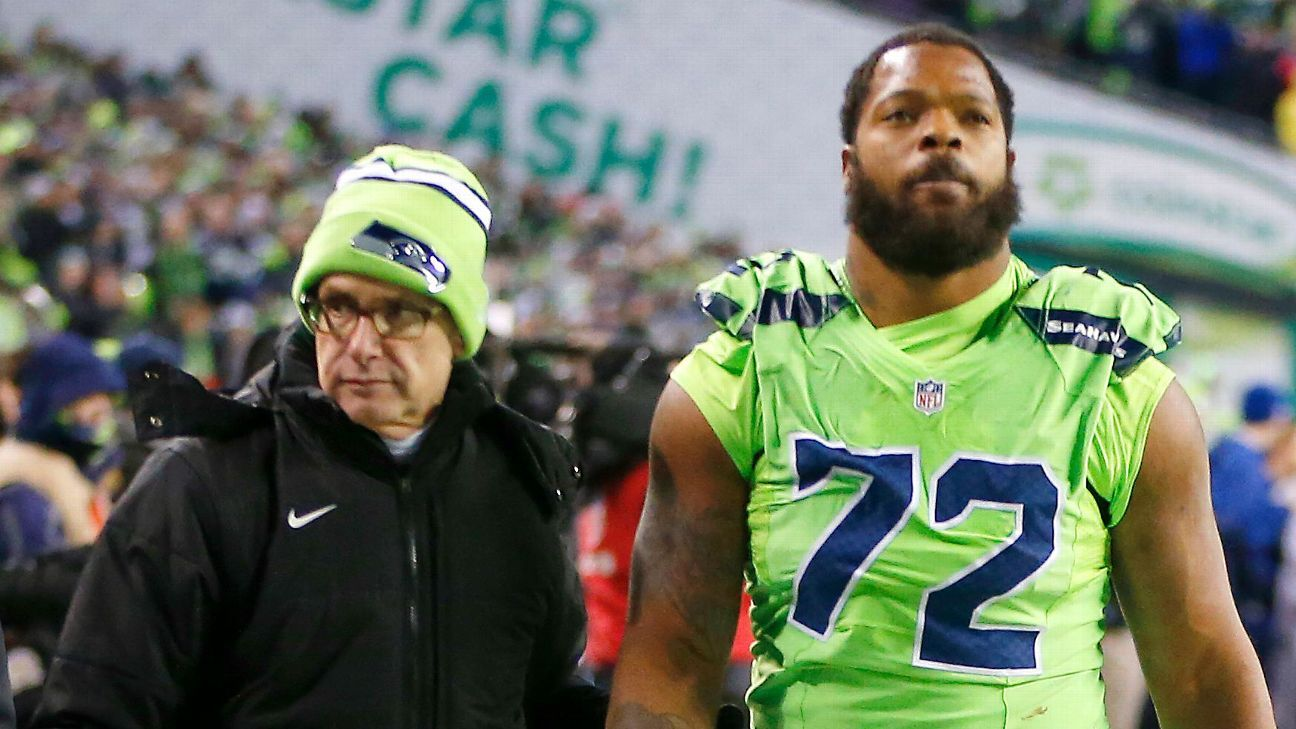 Michael Bennett of Seattle Seahawks exits against Los Angeles Rams with possible concussions