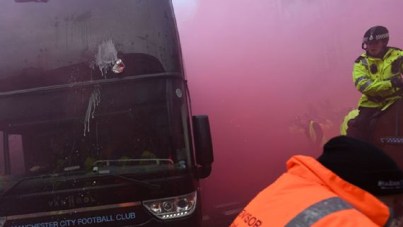 Liverpool fans throw bottles, aim fireworks at Manchester City bus