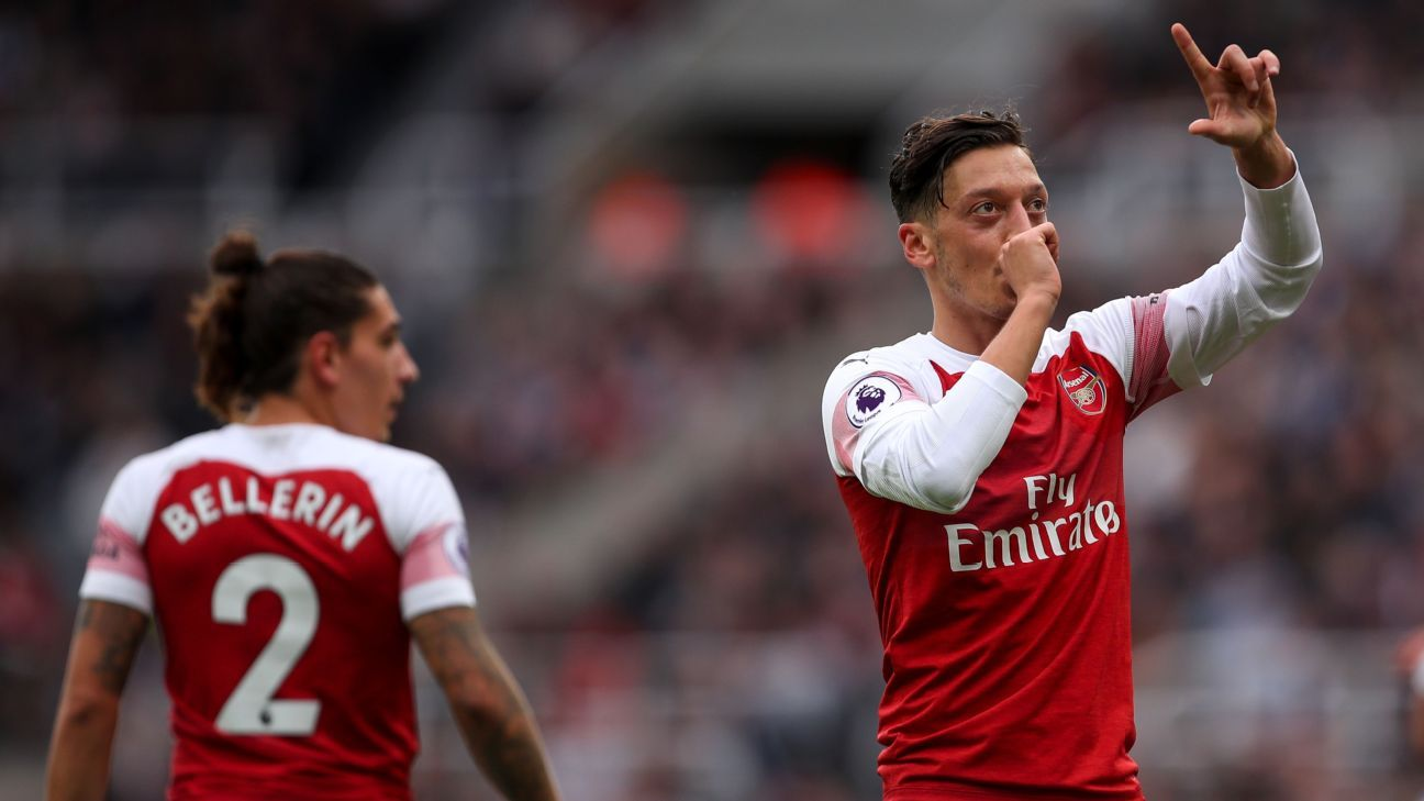 Arsenal's Ozil 'very happy' to play for Emery