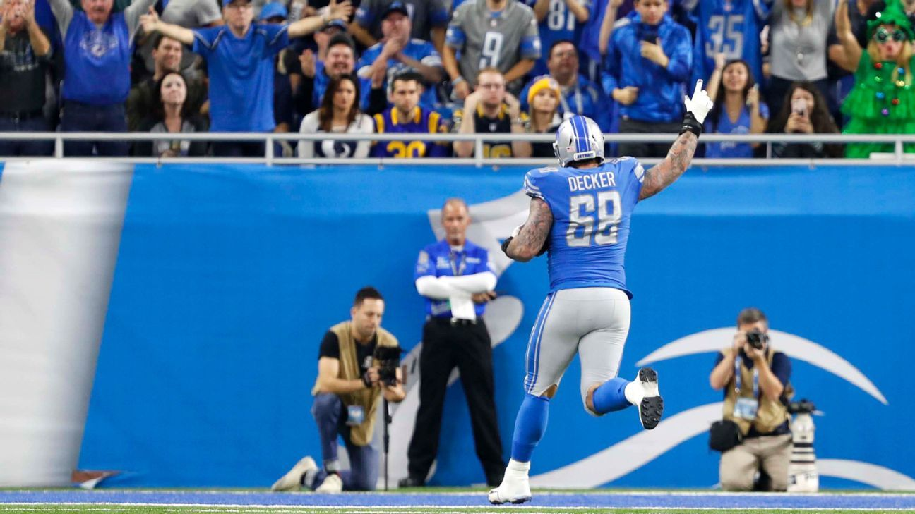 Lions offensive lineman Taylor Decker is trying to recover the football from his first NFL touchdown.