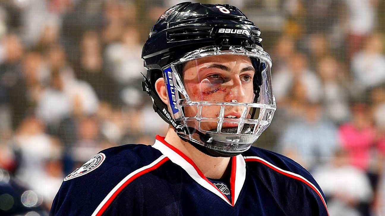Columbus Blue Jackets' Zach Werenski exits game after puck to face