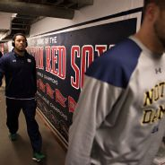 Players arrive through the Red Sox dugout tunnel