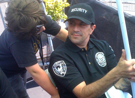 DLX's Jim Thiebaud forgoes badge-waving access to the event by posing as security personnel.