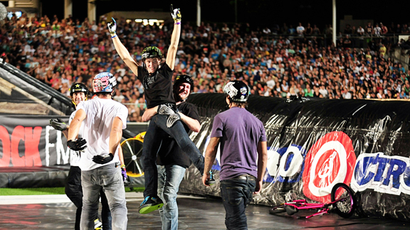 Andy Buckworth, surrounded by fans and friends just after landing the world's first no-handed double frontflip during the New Zealand leg of the Nitro Circus tour.