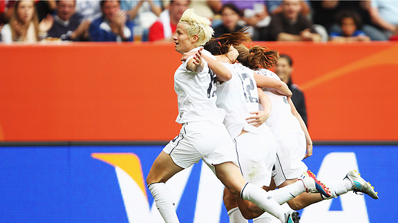 Megan Rapinoe, left, celebrates with teammates after scoring the second goal for the U.S. during their Group C match against Colombia on Saturday.