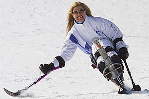 Amanda Boxtel rides a monoski in Aspen to carry the Olympic Torch on its way to Salt Lake City for the 2002 Winter Games.