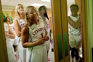 Seniors, including Grace Mashore (No. 1) and Nneka Ogwumike, right, peer through the doors to watch freshmen record video clips for the Maples Pavilion video board.