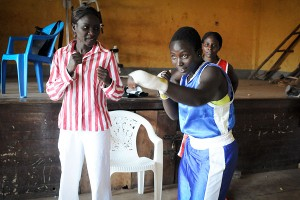 Sixteen-year-old Barbra Nakalema gets some pointers from professional boxer Hawa Daku. Women who make 3 a day at their regular jobs can earn 25 to 50 for a fight.