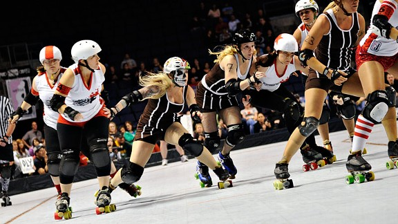 With skaters who had been on wheels for decades, the Oly Rollers, in black, pushed roller derby to a whole new level.
