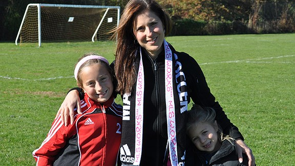 JoAnn Neale says sports can help teach valuable life lessons to children like her daughters Hope, left, and Samantha.
