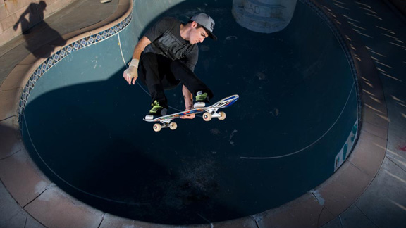 Alex torques a lien air in a backyard pit.
