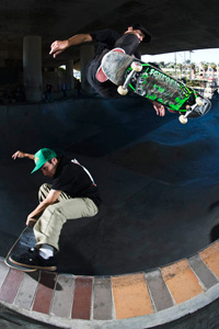 The brothers Perelson doing their thing. Brandon crailsides while Alex frontside ollies above.