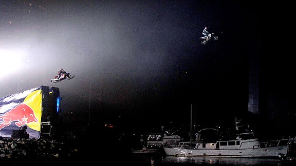 In a history-making moment, Levi LaVallee and Robbie Maddison landed dual jumps over a 300-foot water gap for the 2011 Red Bull: New Year. No Limits event.