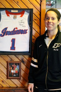 Courtney Moses poses with a display honoring her 2010 Miss Basketball award at a restaurant just outside her hometown.