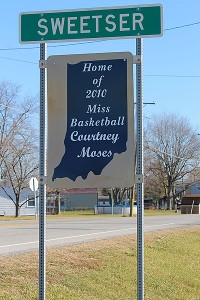 This sign greets visitors at both entrances to Courtney Moses' hometown, Sweetser, Ind.