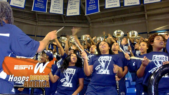 The Force, Hampton's band, is pumped up and proud, putting on a show from start to finish as part of the elaborate production at basketball games.
