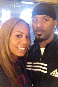 Game faces: Richards-Ross and her husband, Giants cornerback Aaron Ross, pose in Indy the day before Super Bowl XLVI.