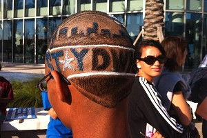 One fan has his Stay Dwight plea shaved into his 'do.