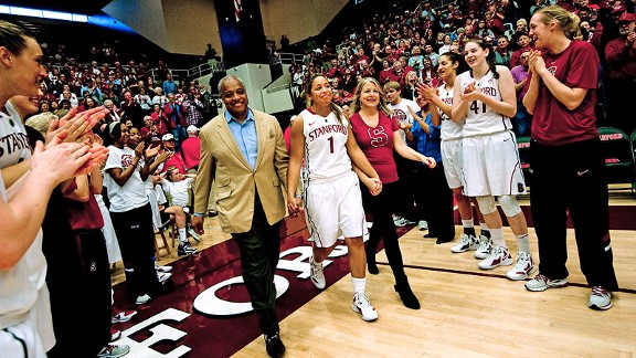 Parents Derrick and Paula Mashore escort Grace on Senior Day in front of an appreciative crowd.