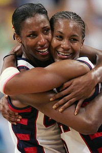 Tamika Catchings, right, and Lisa Leslie celebrate winning a gold medal during Catchings' first Olympics, in 2004. Catchings struggled as an Olympic rookie.