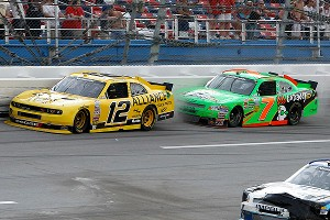 Sam Hornish Jr. (12) puts Danica Patrick (7) into the wall on the final lap of the Nationwide race at Talladega, Saturday. Patrick retaliated on the cool down lap, wrecking Hornish.