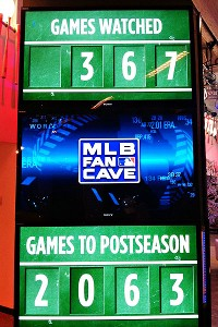 This board shows how many days contestants have been in the Fan Cave and how many games they've watched.