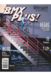 Punjab bombs a huge Pittsburgh rail on the cover of BMX Plus! in 2002.