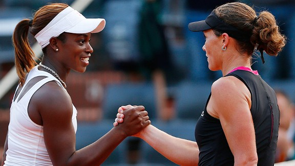 Sloane Stephens, left, shakes hands with Australia's Samantha Stosur after their fourth-round match.