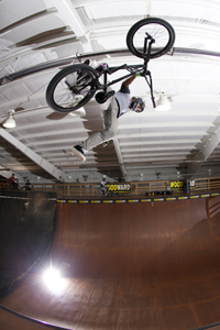 Stylish one-hander one-footer on the Woodward Camp vert ramp.