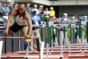 Bryan Clay pushes over a hurdle during the 110-meter hurdles in the decathlon at the U.S. Olympic trials. Clay stumbled and was disqualified.