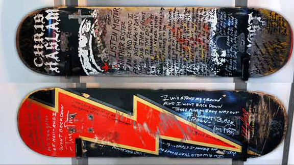 Ben Harper penned Rodney Mullen's board (top), while Mike Vallely had Tom Petty write lyrics on his (bottom).
