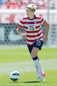 Megan Rapinoe helped the U.S. beat Canada 2-1 in a friendly match serving as a tuneup before the Olympics.