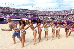 The Horse Guard Parade Dancers entertain the crowd during breaks in the beach volleyball action.