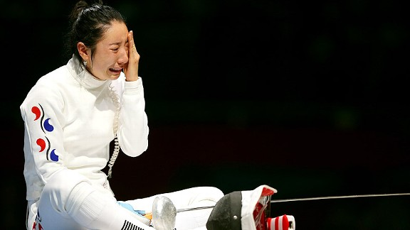 Shin Lam of South Korea reacts after losing the semifinal match in a controversial ending.
