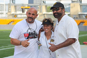 From left, WFA co-founder Jeff King and Pittsburgh Passion co-owners Teresa Conn and Franco Harris at the title game.