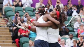 Sisters Venus and Serena Williams, playing here as partners during the London Olympics, will play against each other for the first time since 2009 with a Saturday showdown in the Family Circle Cup semifinals.