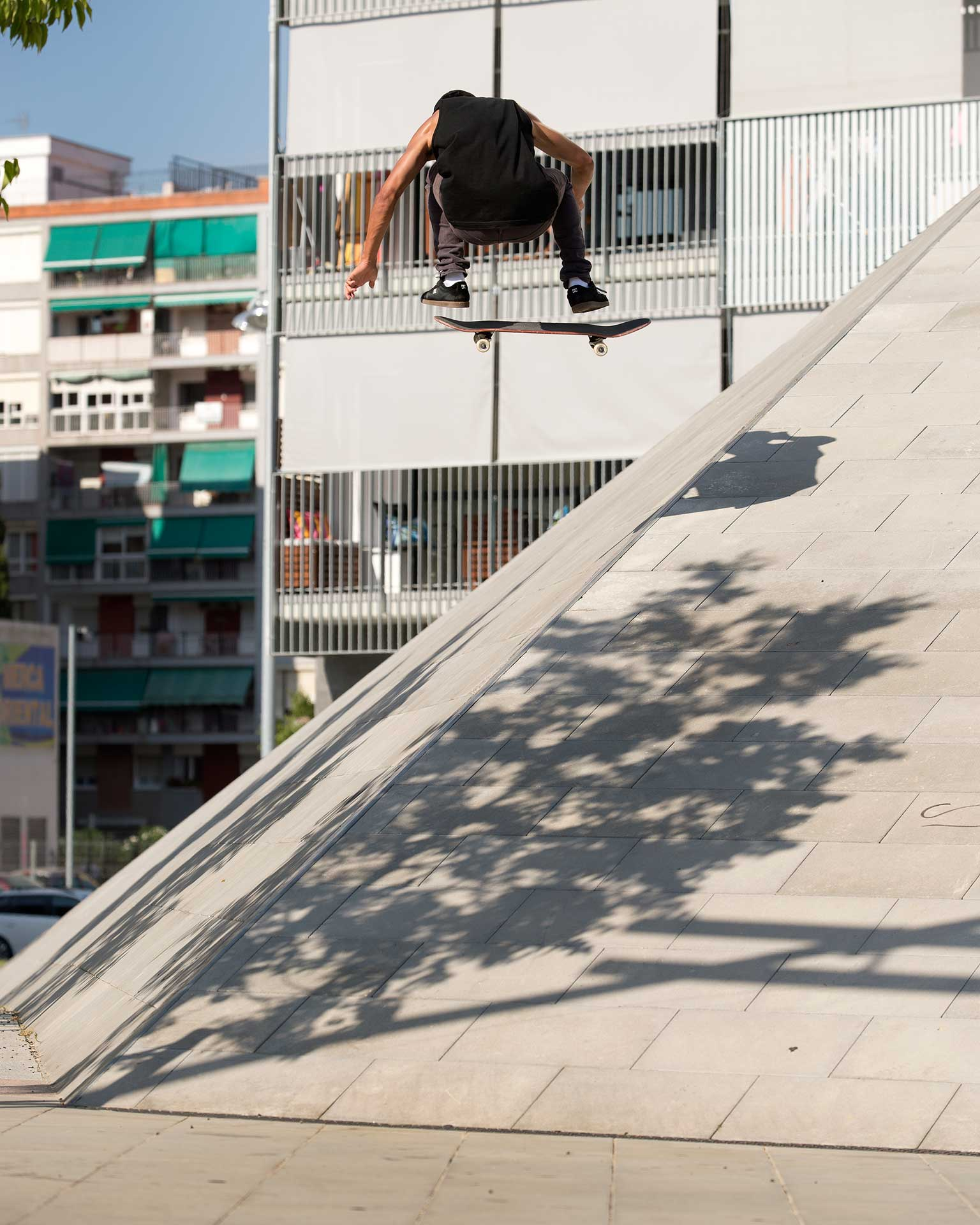 On a recent DC shoes trip to Barcelona, Spain, Nyjah pops a nollie heelflip to fakie over the hip at a picture perfect skate spot.