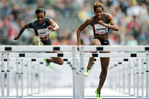Kellie Wells, left, has continued to compete after the Olympics, finishing first in the women's 100-meter hurdles at the ISTAF athletics meeting in Berlin on Sept. 2.