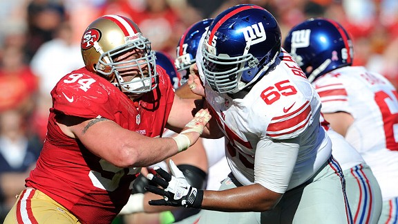 At age 33, Justin Smith, seen battling Giants offensive lineman Will Beatty, plays more than 90 percent of the snaps.