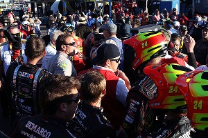 Police break up fights in the garage area after an on-track incident between Clint Bowyer and Jeff Gordon during the Sprint Cup race at Phoenix.