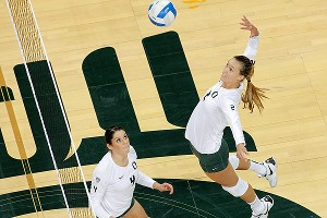 Setter Lauren Plum, left, and hitter Alaina Bergsma have the Oregon Ducks flying high into the postseason.