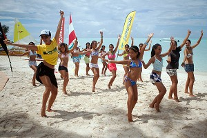 Girls in Tahiti are more likely to dance competitively than play sports, but they fell in love with the stand-up paddle boarding and Holopuni canoes.