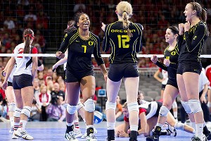 Oregon players Haley Jacob (9), Ariana Williams (7), Katherine Fischer (12), Lauren Plum (4) and Alaina Bergsma (2) celebrate a point in Saturday's victory against Nebraska.