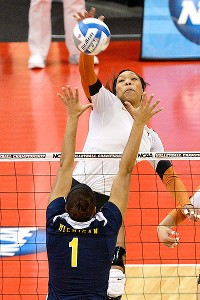 Middle blocker Khat Bell knows how to kill a ball. She had 11 against Michigan.