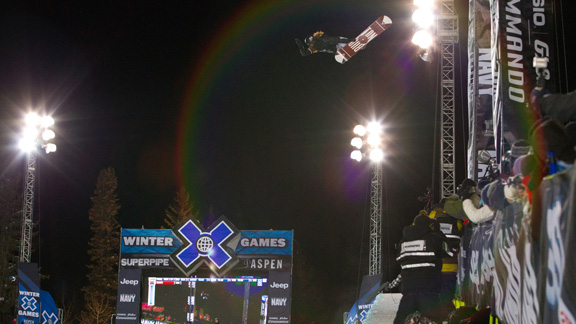 Shaun White with a huge backside air on his way to SuperPipe's only perfect 100 score, at X Games Aspen 2012.