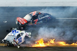 Kyle Larson (32) and Regan Smith (7) were among those involved in a scary crash at the end of the Nationwide Series race Saturday at Daytona.