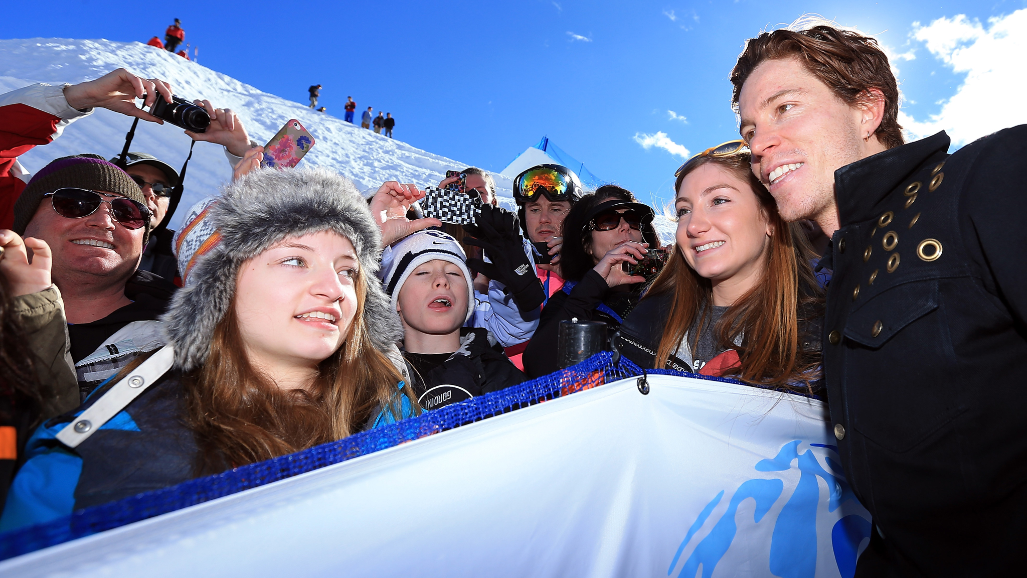 Shaun White (far right) seen at the U.S. Grand Prix in early February, will move into the event organizer role this April.